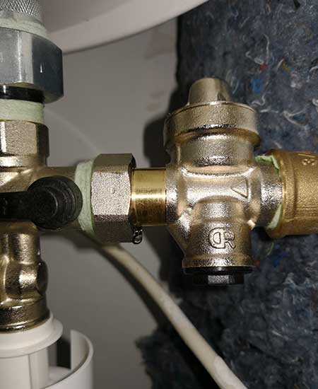 réparer fuite raccord chauffe-eau